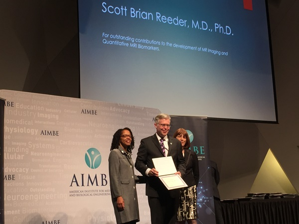 Dr. Reeder receiving AIMBE fellowship certificate