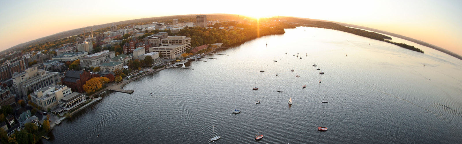 Boats on Lake Mendota looking to the sunrise